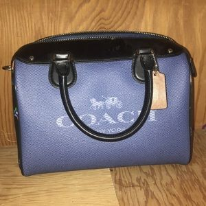Adorable blue coach purse with black\flower accent